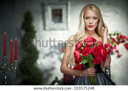 Closeup portrait of fashion model posing with bunch of peonies
