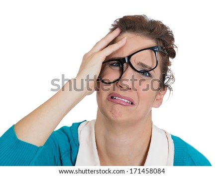 Closeup portrait of frustrated stressed nerdy woman with hand on face, glasses messed up, upset about to cry isolated on white background. Negative emotion facial expression feelings, body language - stock photo