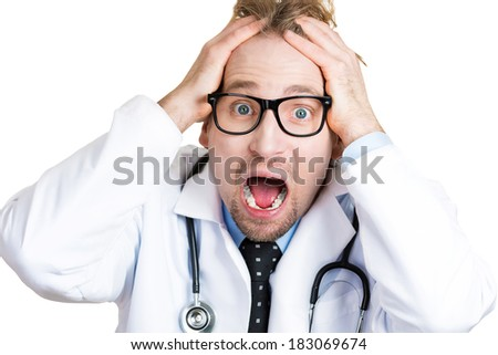 Closeup portrait of frustrated upset overwhelmed, worried young doctor, mad health care professional, screaming, hands on head, isolated on white background. Human face expressions, emotions - stock photo
