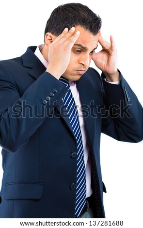 Closeup portrait of frustrated young business man holding his head rubbing temples in stress about to have nervous breakdown, isolated on  white background. Negative human emotion facial expression - stock photo