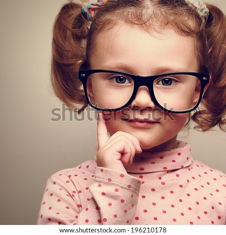 Closeup portrait of fun happy kid girl in glasses. Vintage - stock photo