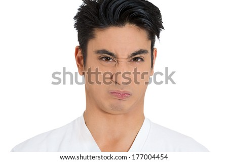 Closeup portrait of funny young man puckering lips, with look of disgust on face, bad crap bitter taste in oral mouth cavity, isolated on white background. Negative emotion facial expression feelings. - stock photo