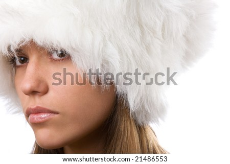 closeup portrait of girl in white fur hat