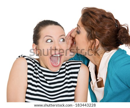 Closeup portrait of girl whispering into woman's ear telling her something secret good news. Happy smiling cheerful toothy response. Positive communication human emotions facial expression feelings - stock photo