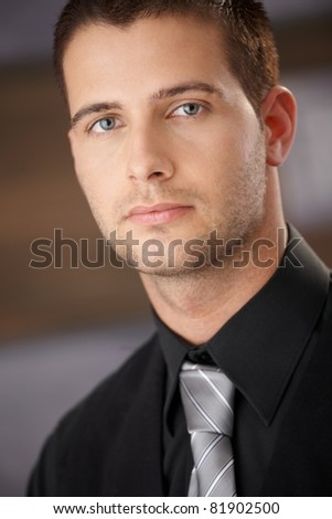 Closeup portrait of goodlooking young businessman.? - stock photo