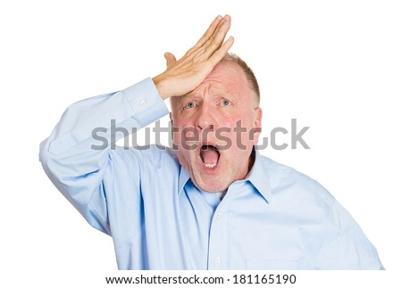 Closeup portrait of goofy, funny face, senior mature man slapping hand on head to say duh, isolated on white background. Negative human emotion facial expression feelings, body language - stock photo
