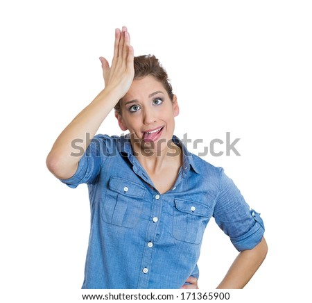Closeup portrait of goofy woman tongue sticking out, slapping hand on head to say duh, isolated on white background. Negative emotion facial expression feelings, body language - stock photo