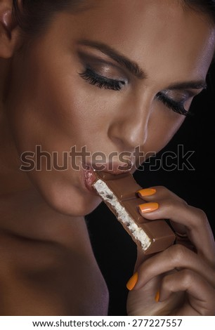 Closeup portrait of gorgeous woman with chocolate. Emotional photo.