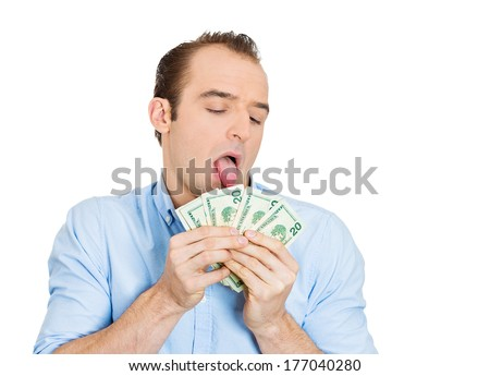 Closeup portrait of greedy banker, CEO boss, corporate employee, crazy guy,  funny looking man obsessed, licking cash, money, dollars with tongue, isolated on white background. Expressions, emotions - stock photo
