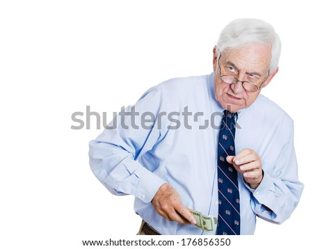 Closeup portrait of greedy senior executive, CEO, boss, old corporate employee, business man, holding dollar banknotes tightly, hiding, possessive, isolated on white background. Negative human emotion - stock photo