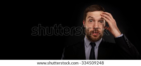 Closeup portrait of handsome bearded businessman looking shocked, surprised in disbelief, with hands on face looking at you camera, isolated on background. Positive human emotions, facial expressions