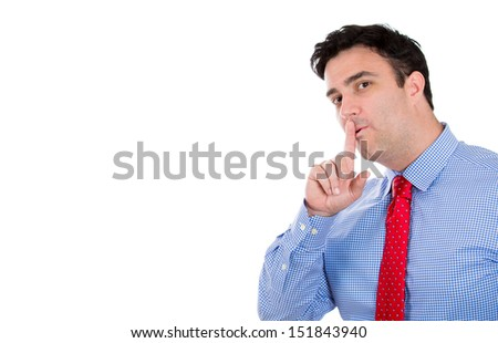 Closeup portrait of handsome businessman placing fingers on lips as if to say shhh, isolated on white background with copy space - stock photo