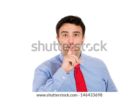 Closeup portrait of handsome businessman placing fingers on lips to say shhh, isolated on white background with copy space - stock photo
