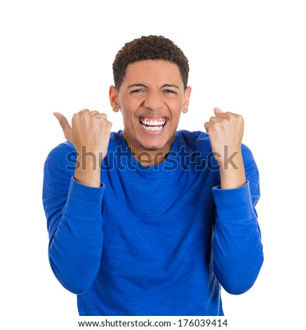 Closeup portrait of handsome excited, energetic, happy, screaming student man winning, arms, fists pumped, celebrating success, isolated on white background. Positive human emotion, facial expressions