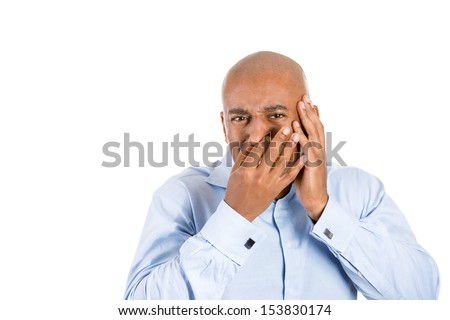 Closeup portrait of handsome guy closing nose because something stinks, isolated on white background with copy space - stock photo