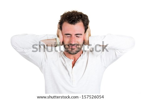 Closeup portrait of handsome man covering his ears isolated on white background. Hear no evil concept. Conflict resolution, interpersonal communication. Human emotions and facial expressions - stock photo