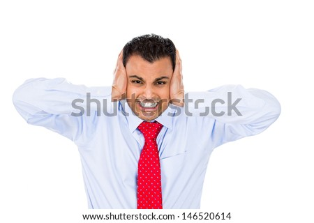 Closeup portrait of handsome man with blue shirt and red tie covering his ears, headache from loud noise, isolated on white background with copy space - stock photo