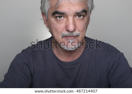 Closeup portrait of handsome mature man