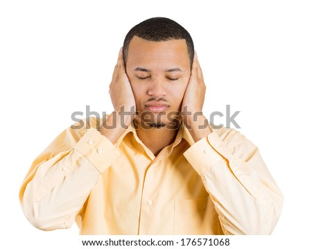 Closeup portrait of handsome peaceful young man covering his ears with hands, closed eyes, isolated on white background. Hear no evil concept. Negative human emotions facial expressions, life feelings - stock photo