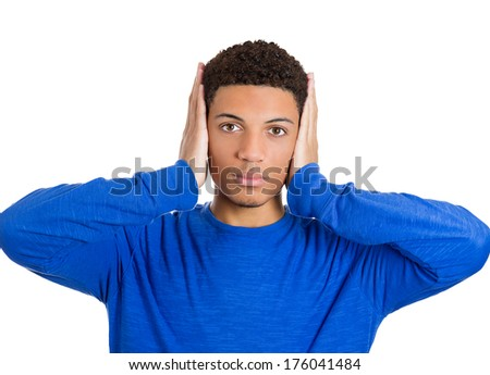 Closeup portrait of handsome peaceful young man covering his ears with hands, open eyes, isolated on white background. Hear no evil concept. Negative human emotions facial expressions, life feelings - stock photo