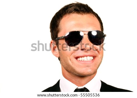 Closeup portrait of handsome pilot in glasses - stock photo