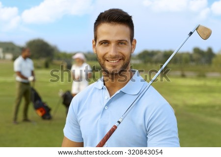 Closeup portrait of handsome young male golfer with golf club. - stock photo