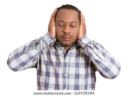 Closeup portrait of handsome young man covering his ears with hands, closed shut mouth and eyes, isolated on white background.  Hear no evil concept. Negative human emotions facial expressions, - stock photo