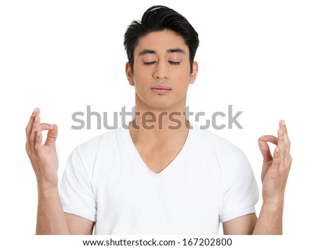 Closeup portrait of handsome, young man in meditation zen mode, isolated on white background. Stress relief techniques concept. Positive human emotions facial expression feelings signs symbols - stock photo