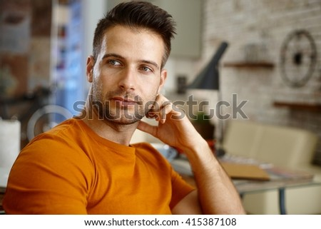 Closeup portrait of handsome young man, looking away. - stock photo