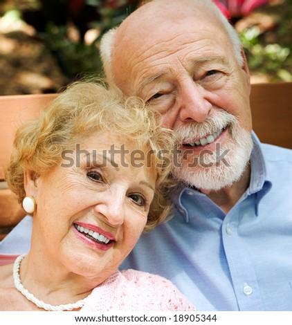 Closeup portrait of happy, attractive senior couple. - stock photo