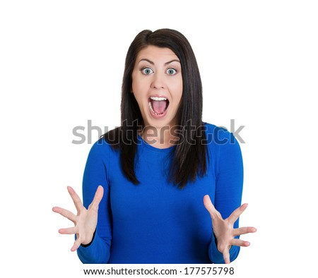 Closeup portrait of happy cute young beautiful woman looking shocked surprised in full disbelief hands in air, screaming isolated on white background. Positive human emotion facial expression feelings