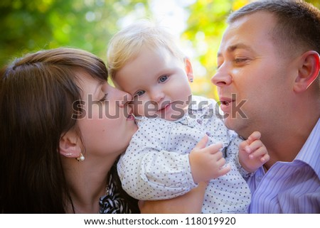 Closeup portrait of happy family outdoors in autumn - stock photo
