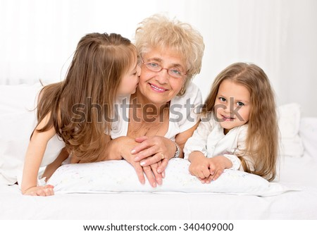 Closeup portrait of happy grandmother with grandchildren - stock photo