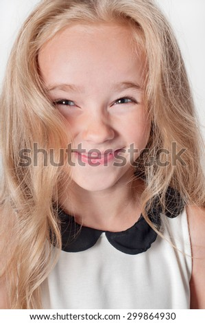 Closeup portrait of happy little girl with long curled hair - stock photo
