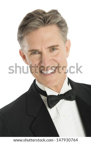 Closeup portrait of happy mature man in tuxedo isolated on white background - stock photo