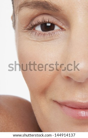 Closeup portrait of happy middle aged woman with pretty smile on white background