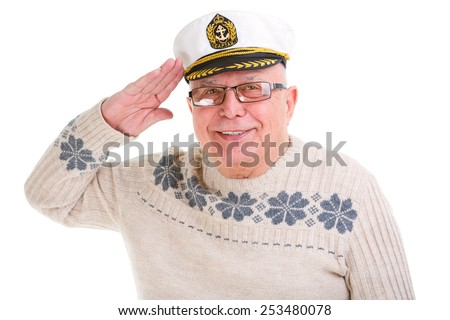 Closeup portrait of happy old senior man saluting with a boat captain cap. Isolated - stock photo