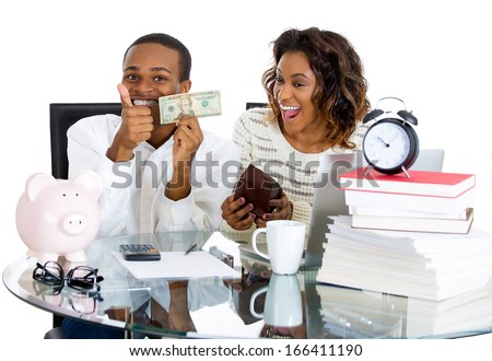 Closeup portrait of happy, proud, smiling couple excited to pay off debts and have extra cash,  isolated on white background. Positive human emotion facial expression feelings. Financial success - stock photo