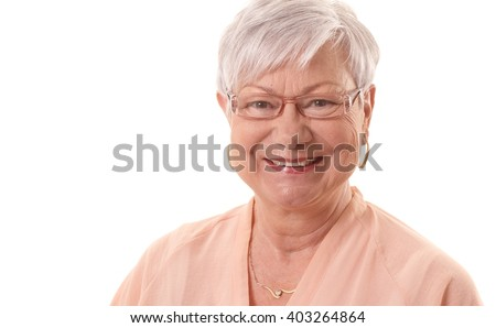 Closeup portrait of happy smiling old woman looking at camera. - stock photo