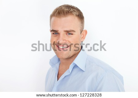 Closeup portrait of happy smiling young businessman on white background - stock photo