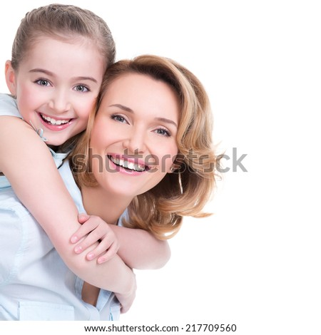 CLoseup portrait of happy  white mother and young daughter - isolated. Happy family people concept. - stock photo