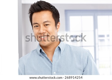 Closeup portrait of happy young Asian man. - stock photo