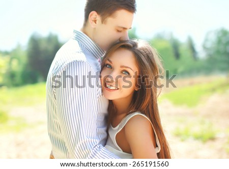 Closeup portrait of happy young couple in love, sunny summer day