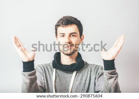 Closeup portrait of happy young handsome man looking shocked surprised in full disbelief hands in air open mouth eyes, isolated on white background. Positive human emotion facial expression feeling