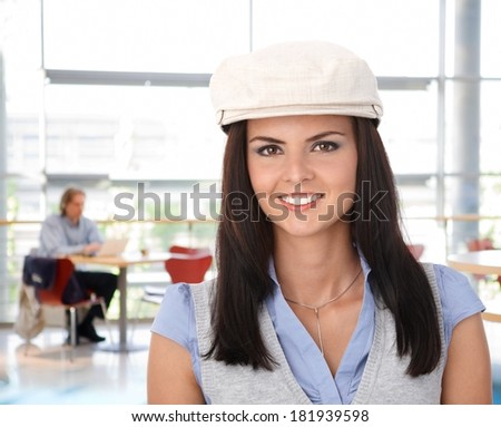 Closeup portrait of happy young woman in casual hat. - stock photo