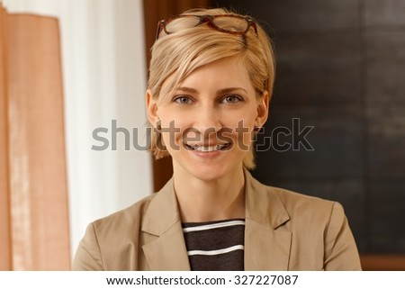 Closeup portrait of happy young woman smiling, looking at camera.
