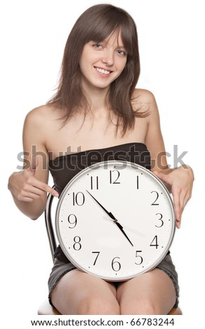 Closeup portrait of  happy young woman smiling with clock