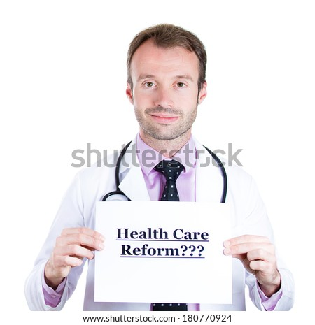 Closeup portrait of health care professional doctor with stethoscope holding up sign which says health care reform? isolated on white background.  - stock photo