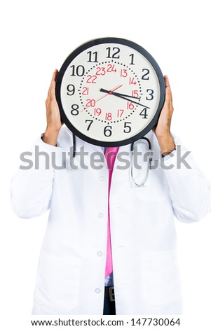 Closeup portrait of health care professional or doctor or nurse with stethoscope holding up clock in front of face, isolated on white background - stock photo