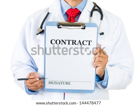 Closeup portrait of health care professional with stethoscope and red tie, holding a contract sign and showing with pen a place for signature, isolated on white background
